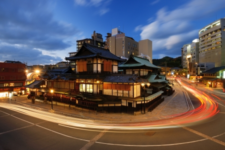 all in one: Dogo Onsen and the cityscape of Matsuyama, Japan. Dogo Onsen is one of the most famous hot spring bath houses in all of Japan.