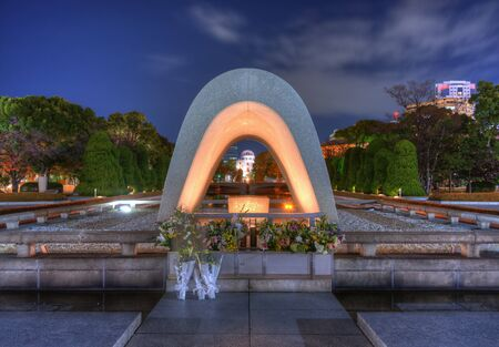 atomic: Cenotaph through which the Atomic Dome can be seen at at Peace Memorial Park in Hiroshima, Japan.