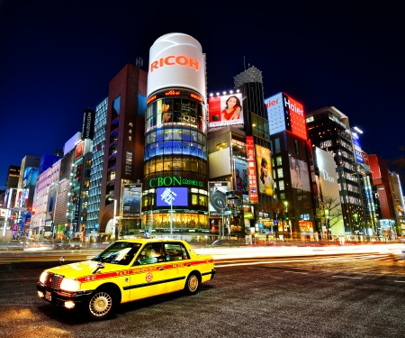 best known: TOKYO - DECEMBER 25, 2012: A Taxi at Ginza District December 25, 2012 in Tokyo, JP. Ginza etends for 2.4 km and is one of the worlds best known shopping districts. Editorial
