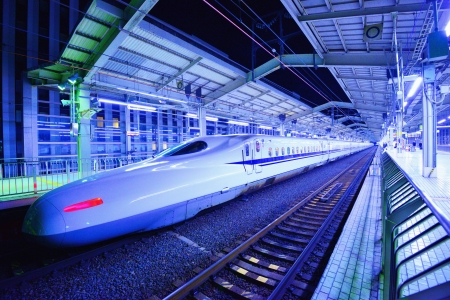 bullet train: KYOTO - JANUARY 21: Japans Bullet Train makes a brief stop January 21, 2013 in Kyoto, JP. The Tokkaido Shinkansen is the worlds busiest high-speed rail line carrying 151 million passengers annually. Editorial
