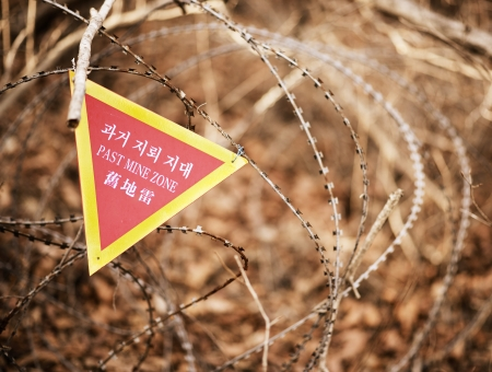 landmine: A sign indicating the end of a landmine zone in South Korea, a poignant reminder of the unresolved conflict in the region.