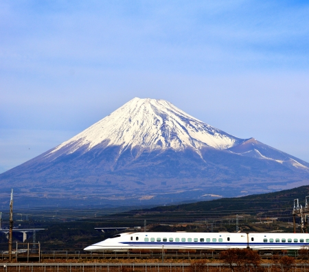 fuji: A bullet train passes below Mt  Fuji in Japan