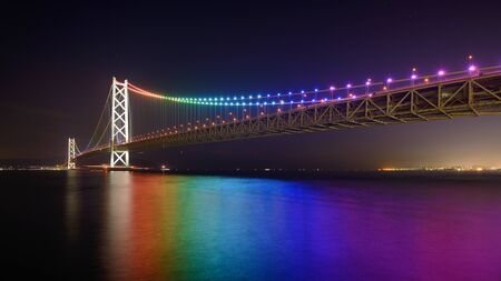 hashi: Rainbow lights on Akashi Ohashi  Pearl Bridge  in Kobe, Japan