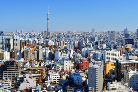 The Tokyo Sky Tree towers above the dense skyline of Tokyo, Japan