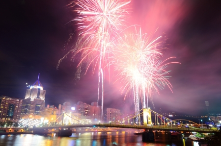 Fireworks on the Allegheny river in downtown  Pittsburgh, Pennsylvania, USA. Stock Photo - 18332306