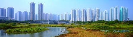 swampland: High rise apartments above Wetland Park in Hong Kong, China.