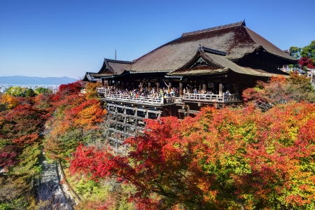 dera: KYOTO - NOVEMBER 19: Tourist observe the annual autumn colors at Kiyomizu-dera Temple November 19, 2012 in Kyoto, JP. Founded in the 700s, the present stage structure dates from 1633.