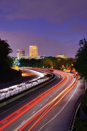 sc: Greenville, South Carolina skyline above the flow of traffic on Interstate 385.