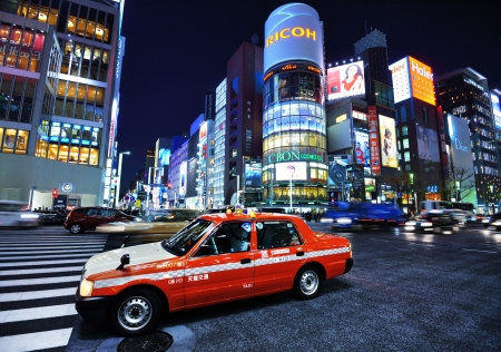 24 26: TOKYO - DECEMBER 26: A taxi stops in the Ginza District December 26, 2012 in Tokyo, JP. The Ginza district extends for 2.4 km and is one of the worlds best known shopping districts.