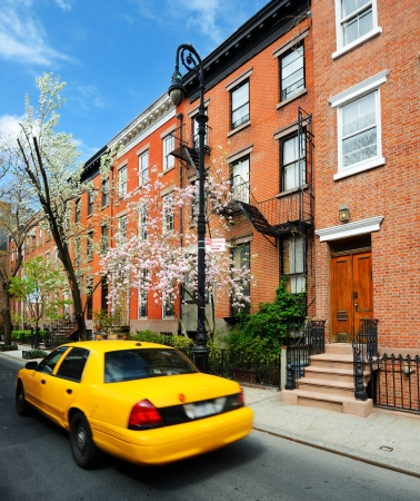 greenwich: Yellowcab passes by Greenwich Village apartments in New York City. Stock Photo