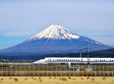 fuji san: A bullet train passes below Mt. Fuji in Japan.