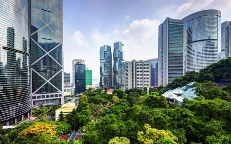 china business: Modern skyscrapers viewed from Hong Kong Park in Hong Kong, China.