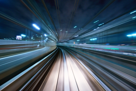 monorail: Motion blur of a city and tunnel from inside a moving monorail in Tokyo.