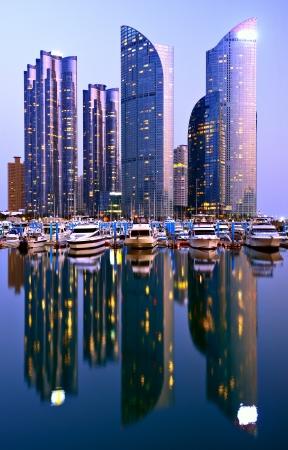 bay city: Skyline of Busan, South Korea at night.