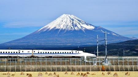 mt fuji: A bullet train passes below Mt. Fuji in Japan.