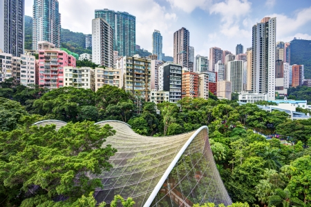 urban apartment: High rise apartments above Hong Kong Park and aviary in Hong Kong, China. Stock Photo