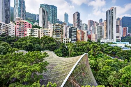 swampland: High rise apartments above Hong Kong Park and aviary in Hong Kong, China. Stock Photo