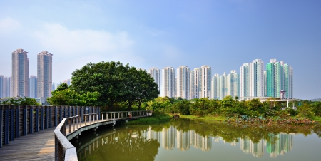 sustainable development: High rise apartments above Wetland Park in Hong Kong, China.