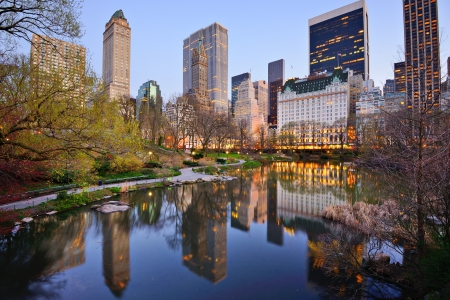city park skyline: Central Park South skyline from Central Park Lake in New York City. Stock Photo