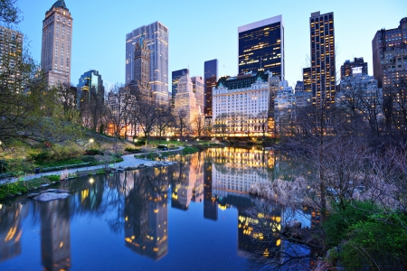 midtown manhattan: Central Park South skyline from Central Park Lake in New York City. Stock Photo