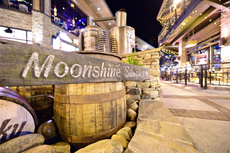 federally: GATLINBURG, TENNESSEE - JUNE 11: Ole Smoky Moonshine Holler June 11, 2013 in Gatlinburg, TN. It is the first federally licensed distillery in the history of East Tennessee. Editorial