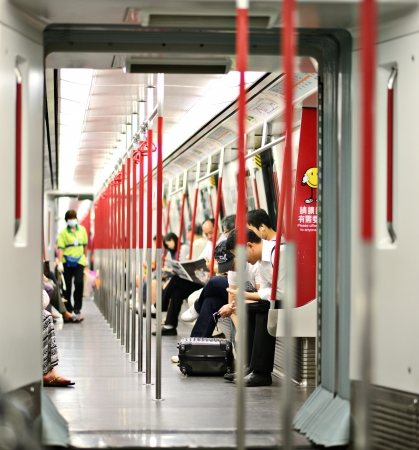hand rails: HONG KONG - OCTOBER 15: Riders on the MTR October 15, 2012 in Hong Kong, China. In 2012 the MTR reportedly had 46.4% of the public transport market, making it the most popular transport in Hong Kong.