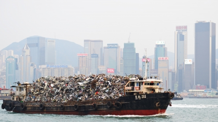 landfills: HONG KONG - OCTOBER 8: Garbage being hauled on boat in Victoria Harbor October 8, 2012 in Hong Kong, China. The dense population means its existing landfills are expected to be full by 2015. Editorial