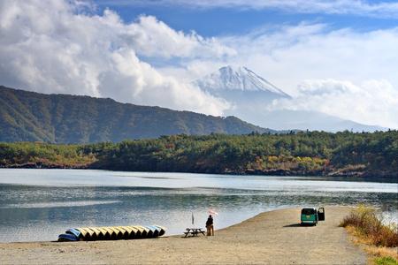 saiko: Fuji Mountain towers over Lake Saiko in Japan.
