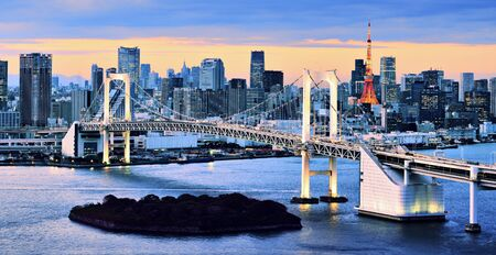 tokyo prefecture: Rainbow Bridge spanning Tokyo Bay with Tokyo Tower visible in the background.