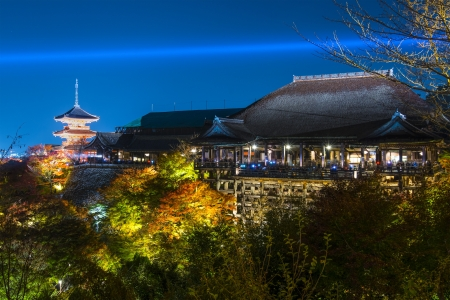 Kyoto, Japan - November 19, 2012: Tourists atop the famed stage at Kiyomizu Dera during the annual fall light show. The temple is one of Japan's most celebrated holy sites.