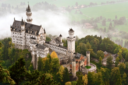 ludwig: Neuschwanstein Castle shrouded in mist in the Bavarian Alps of Germany.