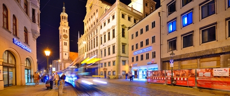 platz: AUGSBURG, GERMANY - SEPTEMBER 28: Traffic in Rathaus Platz September 28, 2013 in Augsburg, Germany. The Bavarian town was once a Free Imperial City for over 500 years.