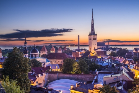 estonia: Skyline of Tallinn, Estonia at sunset. Stock Photo