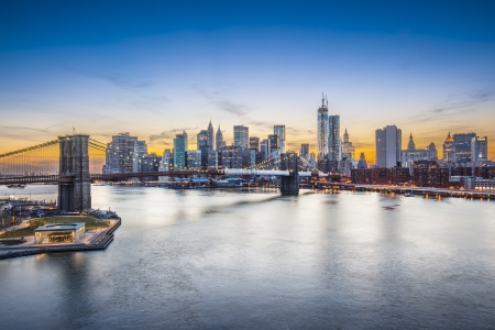 Famous view of New York City over the East River towards the financial district in the borough of Manhattan. photo