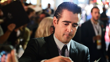 autograph: LOS ANGELES - NOVEMBER 8: The actor Colin Farrell signs an autograph for a fan November 8, 2013 in Los Angeles, CA.