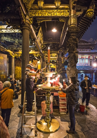 worshipers: TAIPEI, TAIWAN - JANUARY 12: Worshipers at Longshan Temple January 12, 2013 in Taipei, TW. The temple was originally built by Fujianese settlers in 1738. Editorial