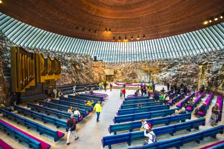 HELSINKI - SEPTEMBER 10: Interior of Temppeliaukio Church September 10, 2013 in Helsinki, Finland. The interior was excavated and built directly out of solid rock.