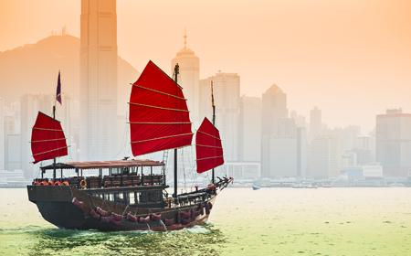 junk: Junk Ship sails in Victoria Harbor in Hong Kong, China.