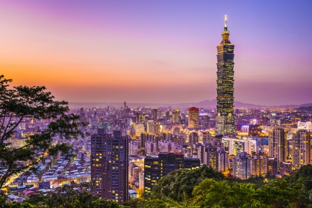 Modern office buildings in Taipei, Taiwan at dusk. Stock Photo - 24480560