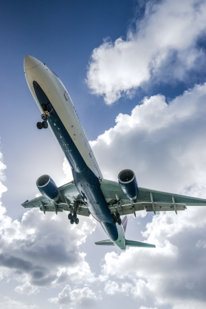 juliana: A commercial jet approaches Princess Juliana Airport. Stock Photo