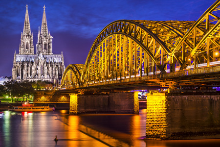 cologne: Cologne, Germany at the cathedral and bridge over the Rhine River.