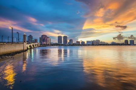 floridian: West Palm Beach, Florida skyline at sunset.