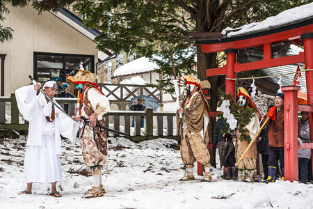 hermits: NAGANO, JAPAN - FEB 4, 2013: Shinto Ascetics perform ancient rites during a procession. Known as Yamabushi, they are mountain hermits with a long tradition of mysticism.