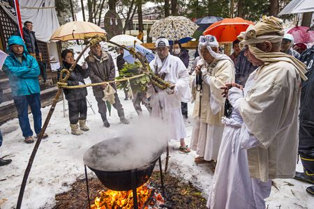 hermits: NAGANO, JAPAN - FEB 4, 2013: Shinto Ascetics perform ancient purifying rites. Known as Yamabushi, they are mountain hermits with a long tradition of mysticism. Editorial