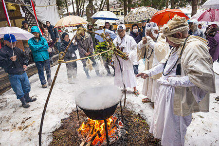 rites: NAGANO, JAPAN - FEB 4, 2013: Shinto Ascetics perform ancient purifying rites. Known as Yamabushi, they are mountain hermits with a long tradition of mysticism. Editorial