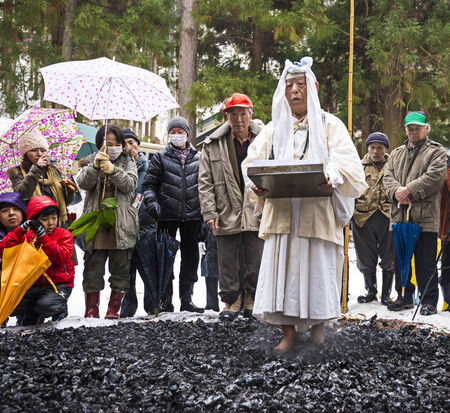 hermits: NAGANO, JAPAN - FEB 4, 2013: Shinto Ascetics firewalk during a Shinto ritual. Known as Yamabushi, they are mountain hermits with a long tradition of mysticism. Editorial