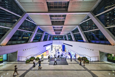 icc: HONG KONG - OCTOBER 9, 2012: Pedestrians pass through the International Commerce Building public lobby. The building is the tallest in the city.