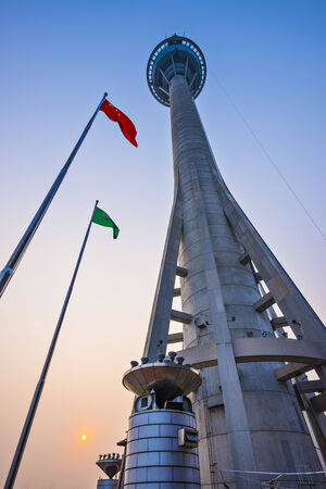 MACAU, CHINA - OCTOBER 12, 2012: Macau Tower exterior at dusk. At 233 meters, the tower offers the second highest commercial bungee jump in the world.