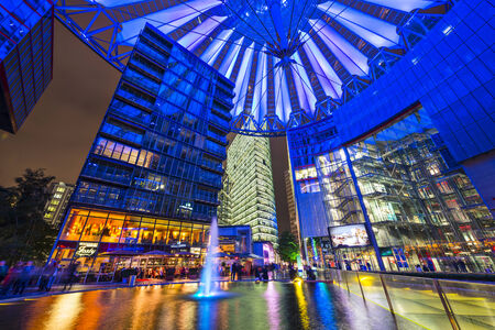 sony: BERLIN, GERMANY - SEPTEMBER 20, 2013: The fountain at night in Sony Center.The center is a public space located in the Potsdamer Platz financial district. Editorial