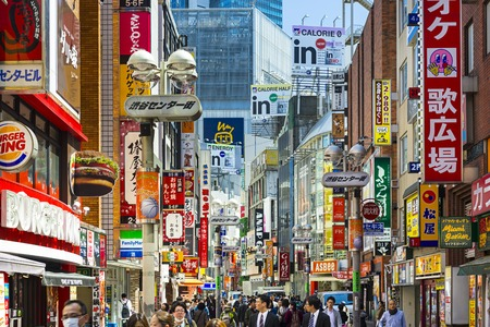 city alley: TOKYO, JAPAN - MARCH 31, 2014: Pedestrians stroll down Shibuya Cener-gai. The area is a popular destination for fashion and shopping.